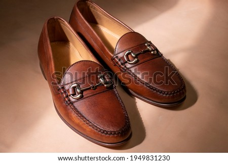 A pair of men's leather bit loafers in the sunlight during a fashion indoor photoshoot. Stock fotó ©