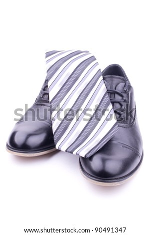 A pair of men's shoes and tie, isolated