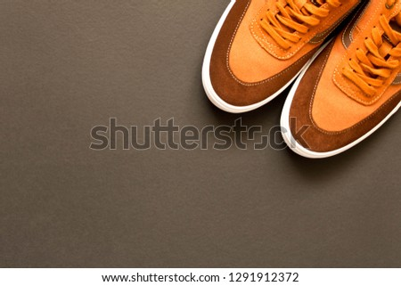A pair of new sneakers on a dark background. Empty text space #1291912372