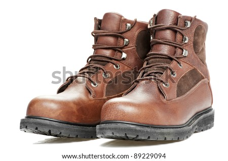 A pair of new work wear winter boots on white background