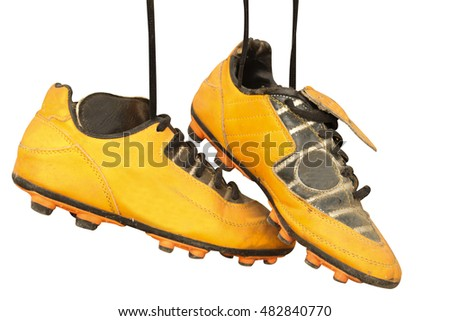 6fbfed36e A pair of old football boots on white background  482840770