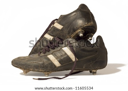 A pair of old football boots, showing signs of good use and age