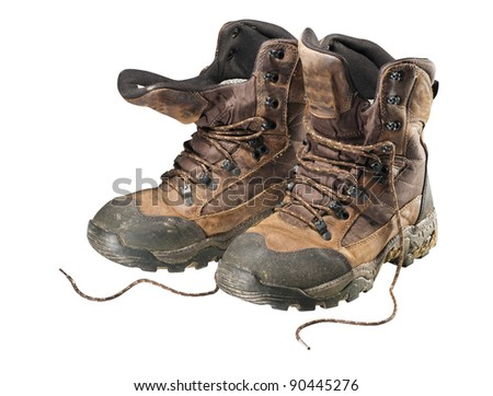 A pair of old hiking boots isolated on white background