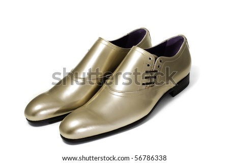 a pair of patent leather shoes for man isolated on a white background
