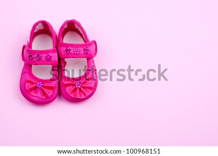 a pair of pink baby shoes - stock photo