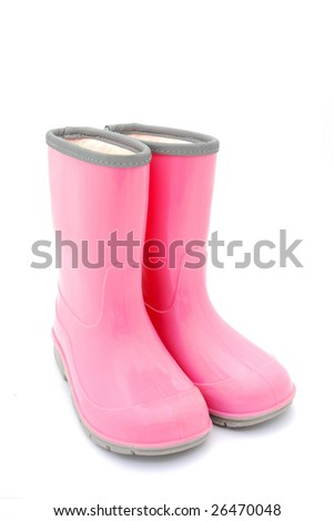 A pair of pink kids gum boots for rainy weather isolated on white studio background