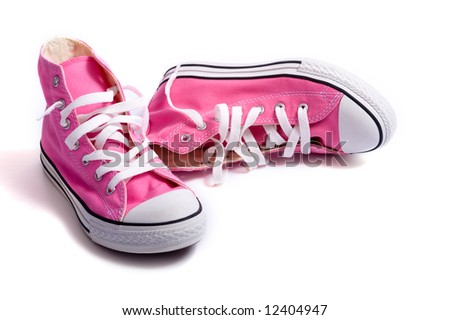A pair of pink vintage styled canvas basketball shoes or sneakers on a white background with copy space