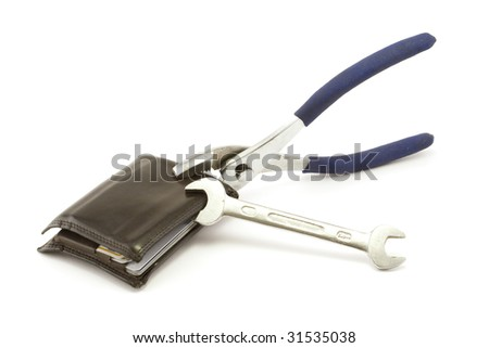 A pair of pliers and a wrench grab hold of a wallet