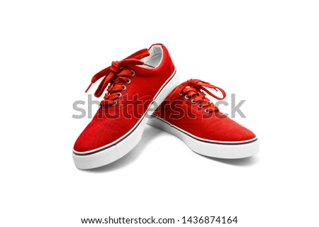 A pair of Red canvas shoes isolated on white background with clipping path #1436874164