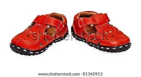 A pair of red children's leather shoes on a white background