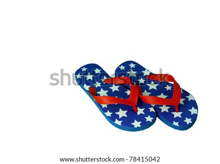 A pair of red, white, and blue 4th of July flip-flops isolated on white.
