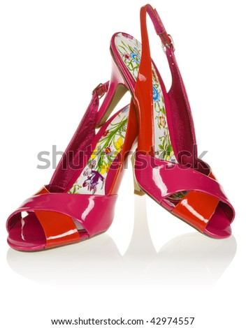 A pair of red women's high-heel shoes on white background