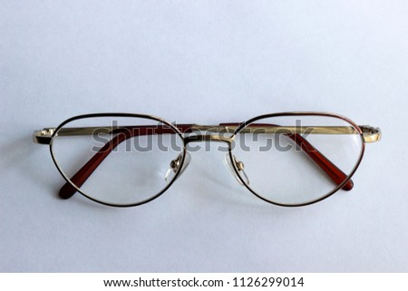 d0fcefdce6c A pair of round glasses isolated on white background. Symmetrical top view  photo in minimalistic
