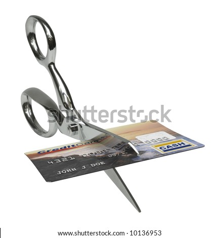 A pair of scissors cutting a credit card in half on a white background