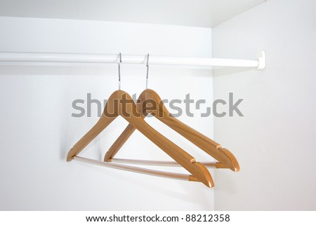 A pair of shoulders in empty wardrobe
