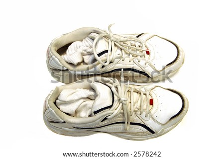 A pair of sneakers against a white background