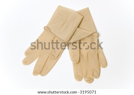 A pair of sterile surgical gloves shot against a white background