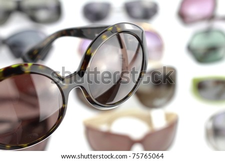 A pair of sunglasses with glasses background