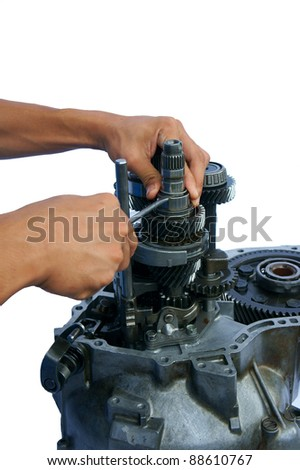 a pair of technician hand fixing the car gearbox - stock photo