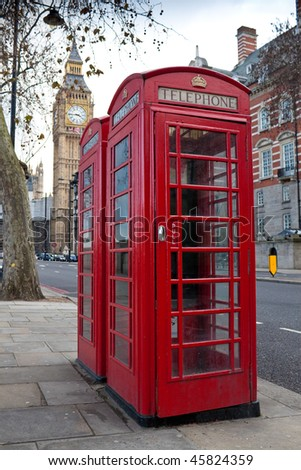 A pair of traditional red phone booths in London with the Big Ben in the background