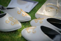 a pair of wedding shoes and wedding rings