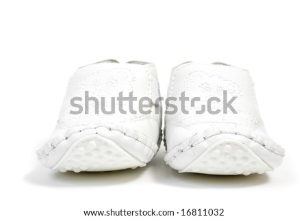 a pair of white baby shoes