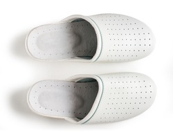A pair of white professional ventilated work clogs isolated over white