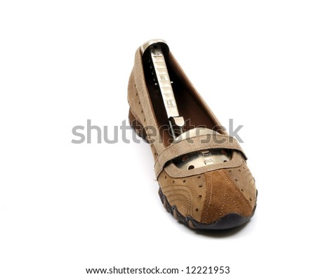a pair of womens brown leather sandals against a white