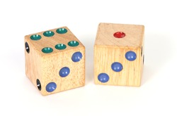 a pair of wooden throwing dice
