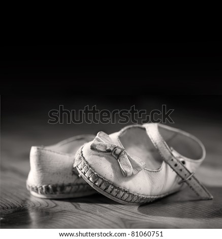 A pair of worn out baby shoes. Nostalgic image suitable for Mothers Day/Fathers Day/Grandparents Day or for birth announcement. Space for your text