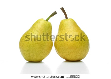 A pair of yellow pears side by side over a white background. Look for more fruits and vegetables at my gallery