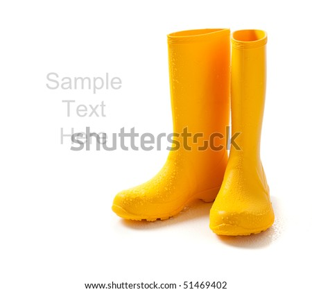 A pair of yellow rain-boots  on a white background with copy space