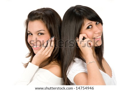A pair of young women on the phone together