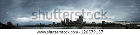 A panorama of Cincinnati Ohio under a cloudy sky.