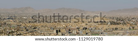 A panorama of new high-rises in Kabul Afghanistan against the backdrop of surrounding mountains