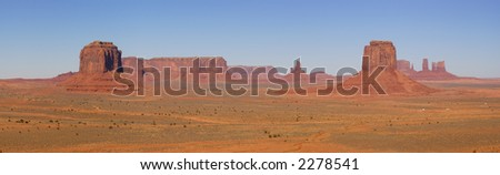 A panorama of the Monument Valley (Navajo Nation) made on fine autumn morning - a classic Southwest view.