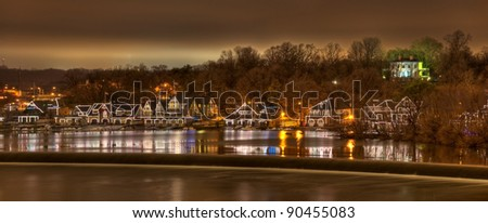 A panorama of the scenic boathouse row at night on the Schuylkill River in Philadelphia, Pennsylvania.
