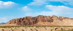 A panorama of the steep red bluffs at the west end of Bitter Ridge in Gold Butte National Monument, Clark County, Nevada