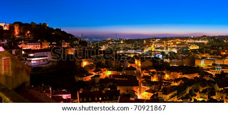 A panorama over Alfama District in Lisbon - night view - stock photo