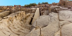 A panorama view of an unfinished obelisk in a quarry near Aswan, Egypt in summer