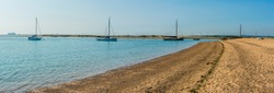 A panorama view of Blackwater estuary from the shore at West Mersea, UK in summertime