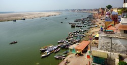 A panoramic bird's eye view of the ancient city of Varanasi with the holy Ganges river flowing by it.