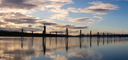 A panoramic photo of wood pilings in the Pend Oreille RIver in October in Cusick, Washington.