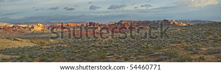 A panoramic view of a sunrise on the sage and red sandstone desert of Valley of Fire State Park, Nevada.