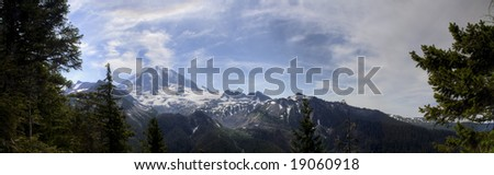 A panoramic view of Mt. Rainier on a summer day