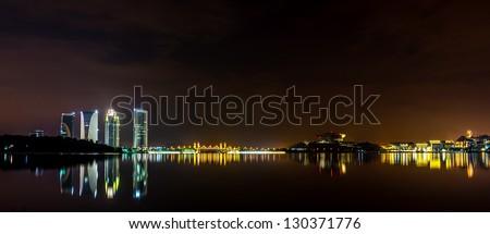 A panoramic view of Putrajaya's lake with reflection at night scene