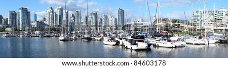 A panoramic view of south Vancouver BC skyline & sailboats in False creek, Canada.