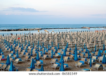 a panoramic view of the beach with chairs and umbrellas