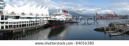 A panoramic view of the Burrard Inlet waterway at Canada place a cruise ship and surroundings.