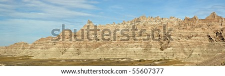 A panoramic view of the colorful layers of the eroding sandstone in Badlands National Park, South Dakota.